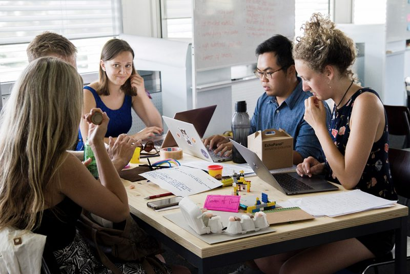 Young adults around a table sharing job search tips